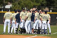 Notre Dame Fighting Irish team huddle before a game vs the Penn State Nittany Lions at the Big East-Big Ten Challenge at Walter Fuller Complex in St. Petersburg, Florida;  February 20, 2011.  Notre Dame defeated Penn State 8-5.  Photo By Mike Janes/Four Seam Images
