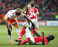 Blackpool's Armand Gnanduillet picks up  Charlton Athletic's Mark Marshall after tangle<br /> <br /> Photographer David Shipman/CameraSport<br /> <br /> The EFL Sky Bet League One - Charlton Athletic v Blackpool - Saturday 16th February 2019 - The Valley - London<br /> <br /> World Copyright © 2019 CameraSport. All rights reserved. 43 Linden Ave. Countesthorpe. Leicester. England. LE8 5PG - Tel: +44 (0) 116 277 4147 - admin@camerasport.com - www.camerasport.com