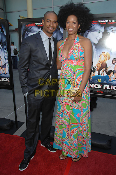 DAMON WAYANS JR. & KIM WAYANS.Paramount presents Dance Flick Los Angeles Premiere held at The Arclight Theatre, Hollywood, California, USA..May 20th, 2009.full length long maxi dress paisley blue pink green halterneck black suit hand in pocket brother sister sibling family .CAP/ADM/KB.©Kevan Brooks/AdMedia/Capital Pictures.
