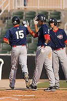 David Marks (15) of the Greenville Drive is greeted at home plate by teammates Michael Almanzar (23) and Will Vazquez (10) following his 2-run home run at Fieldcrest Cannon Stadium in Kannapolis, NC, Sunday August 10, 2008. (Photo by Brian Westerholt / Four Seam Images)