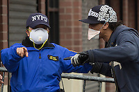 A NYPD officer sgives information to a resident near the scene where a powerful explosion knocked two residential buildings in East Harlem killing 2 people and injuring at least 22 others in New York. March 12, 2014. Photo by Eduardo Munoz Alvarez/VIEW