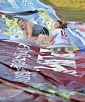 NWA Democrat-Gazette/BEN GOFF &bull; @NWABENGOFF<br /> Youth ride down a roughly 150 yard waterslide on Saturday Aug. 1, 2015 at the home of Hutch Kufahl in Bentonville. Kufahl, youth pastor at First Baptist Church of Bentonville, organized the waterside as an activity for his Studio 412 high school youth group.