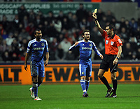Pictured: Ashley Cole of Chelsea (L) sees his first yellow card by referee A Marriner. Tuesday, 31 January 2012<br />
