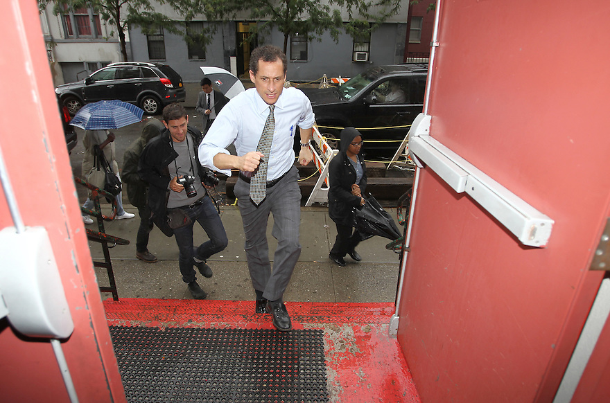 Anthony Weiner  arrives to the Leonard Covello Senior Center on Tuesday, August 13, 2013 in New York. (AP Photo/ Donald Traill)