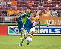 Seattle Sounders midfielder Brad Evans (3) shields the ball from Houston Dynamo midfielder Ricardo Clark (13).  Houston Dynamo tied Seattle Sounders 1-1 on August 23, 2009 at Robertson Stadium in Houston, TX.