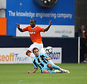 Claude Gnakpa of Luton is tackled by Robbie Willmott of Cambridge United during the Blue Square Bet Premier match between Luton Town and Cambridge United at Kenilworth Road, Luton  on 11th September 2010.© Kevin Coleman 2010