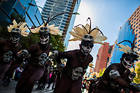 Mexican men, wearing skull masks inspired by Aztecs, dance on the street during the Day of the Dead festival in Mexico City, Mexico, 29 October 2016. Day of the Dead (Día de Muertos), a syncretic religious holiday combining the death veneration rituals of the ancient Aztec culture with the Catholic practice, is celebrated throughout all Mexico. Based on the belief that the souls of the departed may come back to this world on that day, people gather at the gravesites in cemeteries praying, drinking and playing music, to joyfully remember friends or family members who have died and to support their souls on the spiritual journey.