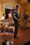 The New Tricks Jazz quartet, featuring Mike Lee on saxophone, Ted Chubb on trumpet, Shawn Baltazor on drums and  on Kellen Harrison on bass, appeared at the Mekeda Ethiopian Restaurant as part of the New Brunswick Jazz Project's Thursday Night Jazz Series.