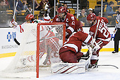 Sahir Gill (BU - 28), Wade Megan (BU - 18), Michael Del Mauro (Harvard - 13), Ryan Carroll (Harvard - 35), Chris Huxley (Harvard - 28) - The Harvard University Crimson defeated the Boston University Terriers 5-4 in the 2011 Beanpot consolation game on Monday, February 14, 2011, at TD Garden in Boston, Massachusetts.