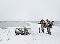 Web Editor for Ducks Unlimited Chris Jennings (cq) enters a duck blind as, OutdoorLife Editor Andrew McKean (cq) and Norris Marshall (cq) prepare for duck hunting in a blind owned by Lynn Berggren (cq)  just off the duck-rich Platte River in Nebraska, Saturday, December 3, 2011...Photo by Matt Nager