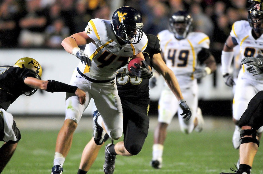18 September 08: West Virginia linebacker Reed Williams (47) returns an interception against Colorado. The Colorado Buffaloes defeated the West Virginia Mountaineers 17-14 in overtime at Folsom Field in Boulder, Colorado. For Editorial Use Only.
