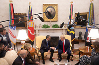 Prime Minister Kyriakos Mitsotakis of Greece, center left, and United States President Donald J. Trump, center right shake hands as Mrs. Mareva Grabowski, left, and first lady Melania Trump , right, look on in the Oval Office at the White House in Washington, D.C. on Tuesday, January 7, 2020.   <br /> Credit: Tasos Katopodis / Pool via CNP/AdMedia