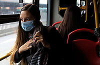 """BOGOTA, COLOMBIA - March 13:  A woman wears a face mask as she rides the public transportation """"Transmilenio"""" on March 13, 2020 in Bogota, Colombia. The World Health Organization declared a global pandemic as the coronavirus rapidly spreads across the world. Colombian President Ivan Duque declared a health emergency to contain an outbreak of coronavirus, suspending public events with more than 500 people. (Photo by John W. Vizcaino/VIEWpress)"""