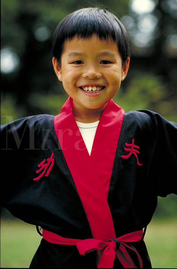 Chinese-American boy in martial art uniform. San Francisco, California.