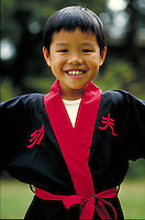 Chinese-American boy in martial art uniform. San Francisco, California.