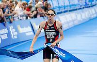 12 JUL 2014 - HAMBURG, GER - Gwen Jorgensen (USA) from the USA wins the elite women's 2014 ITU World Triathlon Series round in the Altstadt Quarter, Hamburg, Germany (PHOTO COPYRIGHT © 2014 NIGEL FARROW, ALL RIGHTS RESERVED)