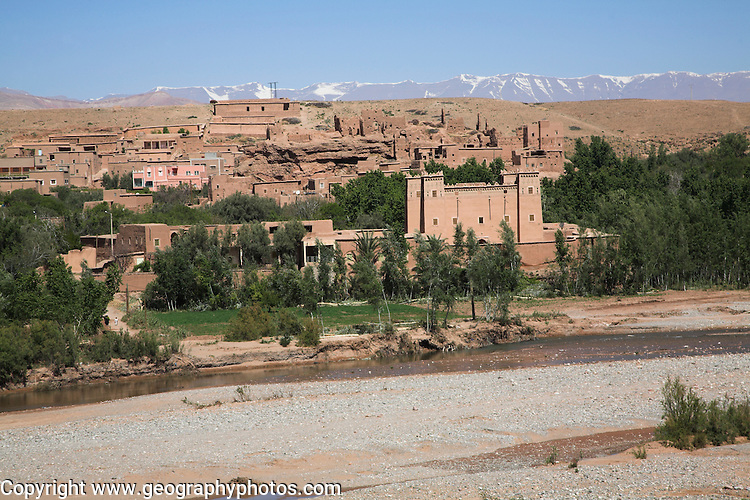 Kalaat M'Gouna with river and snowy peaks of Atlas Mountains, Ourzazate province, Morocco
