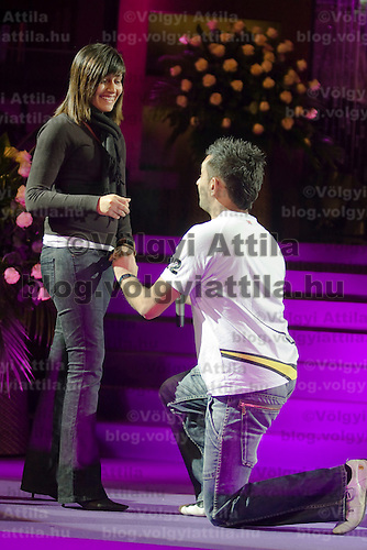 UK citizen Rashik Vishram (R) asks Sunita Harji (L) to marry him in front of the audience just after the Dior fashion show ends in Hotel Sofitel, Budapest, Hungary. Thursday, 26. November 2009. ATTILA VOLGYI