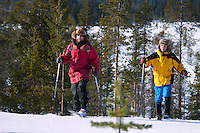"Solberget, Jokkmokk, Swedish Lapland, Sweden, March 2013. Cross country skiing on traditional wooden Sami skis. Dirk and Silke Hagenbusch live their lives in a wilderness retreat  called 'Solberget'. It is situated directly on the Arctic Circle, near the nature reserves ""Granlandet"", ""Päivavuoma"" and ""Pellokiellas"", and close to the ""Muddus"" National Park. Here, nature can be experienced in its purest form – far away from civilisation. As an authentic wilderness farm, Solberget is neither connected to public electricity nor to the mains water supply. Water comes from a spring in the woods and is delicious! Oil lamps and the natural warmth of wood burning stoves provides a soft and cosy atmosphere, even with biting frost outside. Photo by Frits Meyst/Adventure4ever.com"