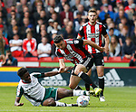 Enda Stevens of Sheffield Utd skips past Ike Ethan Pinnock of Barnsley during the Championship League match at Bramall Lane Stadium, Sheffield. Picture date 19th August 2017. Picture credit should read: Simon Bellis/Sportimage