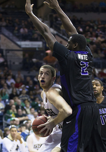 December 21, 2012:  Notre Dame center Garrick Sherman (11) goes up for a shot as Niagara center Devon White (2) defends during NCAA Basketball game action between the Notre Dame Fighting Irish and the Niagara Purple Eagles at Purcell Pavilion at the Joyce Center in South Bend, Indiana.  Notre Dame defeated Niagara 89-67.