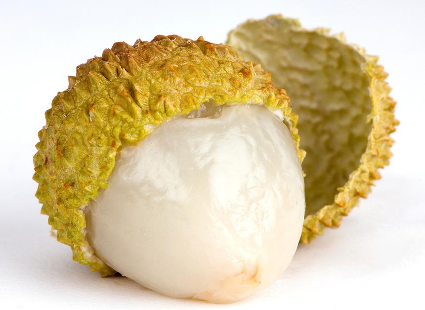 Open Lychee Nuts on white backdrop.