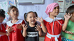 Girls sing in a preschool sponsored by the Kapatiran-Kaunlaran Foundation (KKFI) in Pulilan, a village in Bulacan, Philippines.<br /> <br /> KKFI is supported by United Methodist Women.