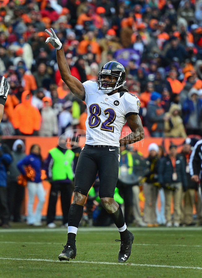 Jan 12, 2013; Denver, CO, USA; Baltimore Ravens wide receiver Torrey Smith (82) celebrates a second quarter touchdown against the Denver Broncos during the AFC divisional round playoff game at Sports Authority Field.  Mandatory Credit: Mark J. Rebilas-