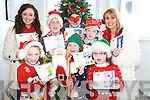 Rachel Lehane, Meadhbh Kissane, Clodagh Foley, Jack Hallissey, Killian Broderick and Emma O'Sullivan with teacher Catherine O'Shea and principal Moira Cronin, Cullina National school, as they announced details of their Christmas cards which the school children designed themselves and got printed for their families and friends.