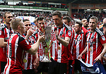 Sheffield United's Chris Basham drinks from the trophy during the League One match at Bramall Lane, Sheffield. Picture date: April 30th, 2017. Pic David Klein/Sportimage
