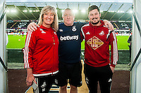 (L-R ) Sue Eames and Micheal Eames with the WHU kit man prior to  the Barclays Premier League match between Swansea City and West Ham United played at the Liberty Stadium, Swansea  on December 20th 2015