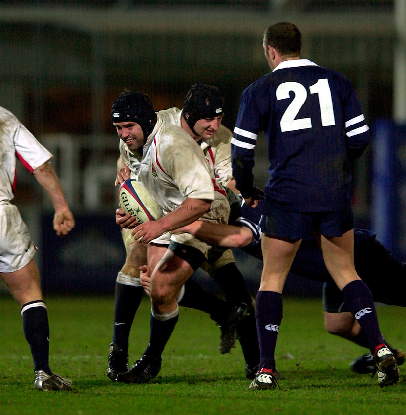Photo. Richard Lane.England A v Scotland A at Franklins Gardens, Northampton. 20/03/2003.Mike Worsley attacks.