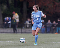 University of North Carolina defender Megan Brigman (3) looks to pass.  University of North Carolina (blue) defeated Boston College (white), 1-0, at Newton Campus Field, on October 13, 2013.