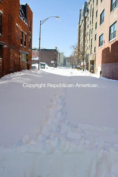 WATERBURY, CT - 9 February 2013-020913EC05--    Some of Waterbury's secondary streets, like Center Street in downtown, remained unplowed Saturday afternoon as crews worked to keep the primary thoroughfares open.  Waterbury received at least 2 feet of snow by Saturday. Erin Covey Republican-American.