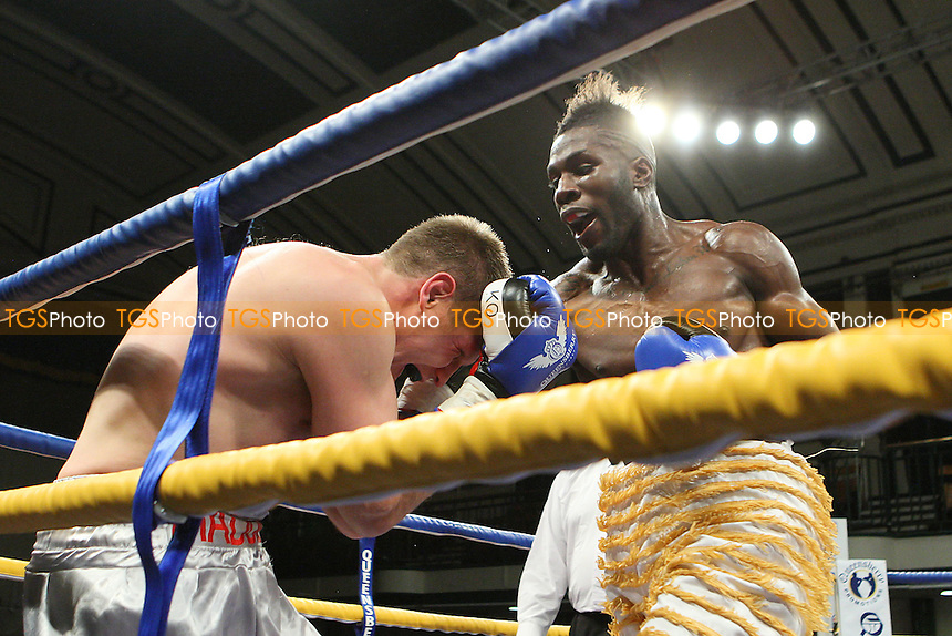 Menay Edwards (gold shorts) defeats Billy Boyle in a Light-Heavyweight boxing contest at York Hall, Bethnal Green, promoted by Queensberry Promotions - 18/11/11 - MANDATORY CREDIT: Gavin Ellis/TGSPHOTO - Self billing applies where appropriate - 0845 094 6026 - contact@tgsphoto.co.uk - NO UNPAID USE.