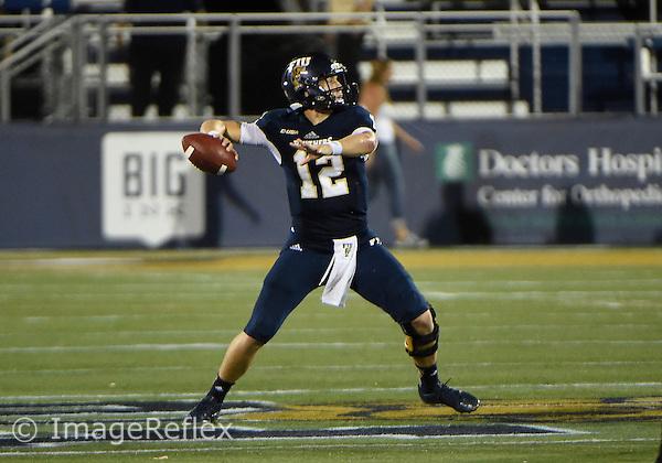 18 October 2014: Florida International University quarterback Alex McGough (12) plays against Marshall University at FIU Stadium, Miami, Florida. Marshall won the game 45-13.