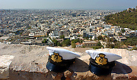 Aug 12, 2004 - ATHENS, CA, GREECE - Two hats that belong to Italian Navy sailors sit on the wall at the Acropolis overlooking Athens, Greece Thursday August 12, 2004. The historic Acropolis is visible from most of the city..(Credit Image: © Alan Greth)