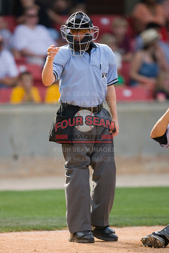 Home plate umpire Gerard Ascani signals a strike call during a Southern League game between the Jacksonville Suns and the Carolina Mudcats at Five County Stadium May 16, 2010, in Zebulon, North Carolina.  Photo by Brian Westerholt /  Seam Images