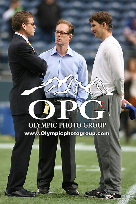 November 07, 2010:  New York Giants quarterback #10 Eli Manning (right) chats before the game with Fox Sports announcer (center) Joe Buck and (left) Troy Aikman against the Seattle Seahawks at Quest Field in Seattle, WA.  New York won 41-7 over Seattle.
