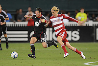 DC United midfielder Santino Quaranta (25) follow by FC Dallas midfielder Brek Shea (20)  FC Dallas defeated DC United 3-1 at RFK Stadium, Saturday August 14, 2010.