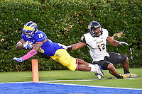 Newark, DE - OCT 29, 2016: Delaware Fightin Blue Hens running back Thomas Jefferson (28) dives in for a touchdown during game between Towson and Delaware at Delaware Stadium Tubby Raymond Field in Newark, DE. (Photo by Phil Peters/Media Images International)