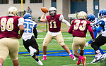 WATERBURY,  CT-101219JS22- Sacred Heart-Kaynor's Alex Gonzalez (11) gets a pass off while being pressured by Crosby's Zyron Hobbs (25) during their game Saturday at Municipal Stadium in Waterbury.<br /> Jim Shannon Republican-American