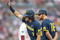Michigan Wolverines outfielder Jesse Franklin (7) points to the Michigan dugout after a hit as first base coach Michael Brdar (360 looks on against the Florida State Seminoles during the NCAA College World Series on June 17, 2019 at TD Ameritrade Park in Omaha, Nebraska. Michigan defeated Florida State 2-0. (Andrew Woolley/Four Seam Images)