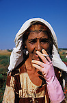 Roma woman sming cigarette. A casual agricultural labourer. Alexandria, Greece 2006