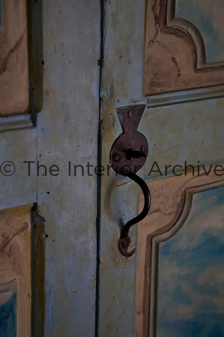 An original painted Catalan door with iron handle, lock and key.