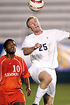 9 November 2005: Virginia's Lee Sandwina (25) heads the ball as Clemson's Dane Richards (10) looks on. Clemson University defeated the University of Virginia 4-1 at SAS Stadium in Cary, North Carolina in a quarterfinal of the 2005 ACC Men's Soccer Championship.