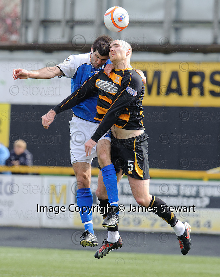 Stranraer's Martin Grehan and  Alloa's Ryan Harding challenge for a high ball.