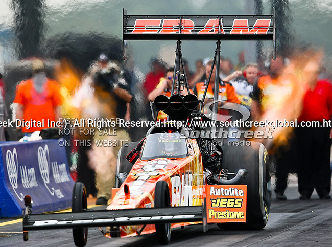 Cory McClenathan #4, driver for Fram's Top Fuel Dragster makes a run at the O'Reilly Fall Nationals held at the Texas Motorplex in  Ennis, Texas.