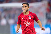 WASHINGTON, DC - OCTOBER 11: Cristian Roldan #15 of the United States warms up during a game between Cuba and USMNT at Audi Field on October 11, 2019 in Washington, DC.