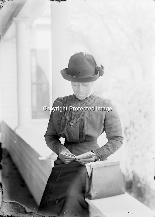 Young Woman with Book.&nbsp;<br />